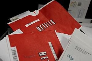 Red Netflix envelopes sit in a bin