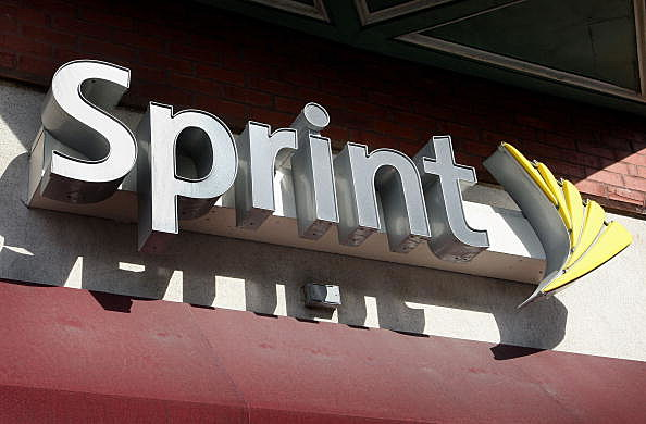 The Sprint Nextel logo hangs above a Sprint retail store