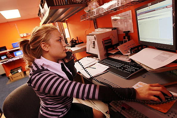Cristine Perez works on customers order at the Geek Squad