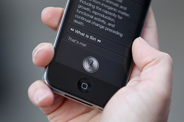 A man uses 'Siri' on the new iPhone 4S
