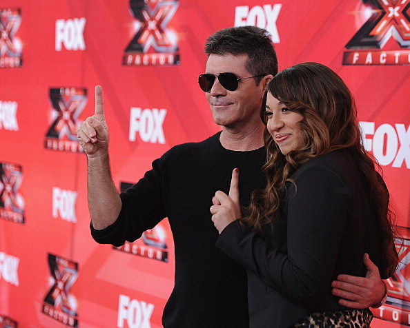 Judge Simon Cowell and contestant Melanie Amaro attend The X Factor Press Conference