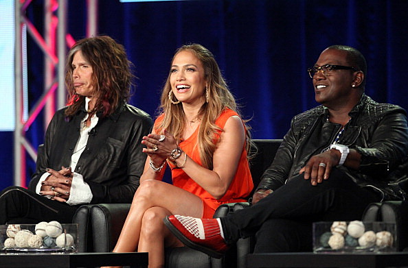 Judges Steven Tyler, Jennifer Lopez, and Randy Jackson speak onstage