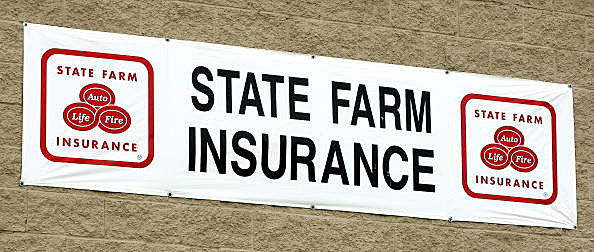 State Farm Insurance signage is seen at an auto claim center