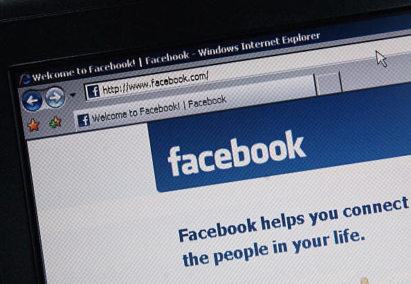 Facebook is displayed on a laptop screen