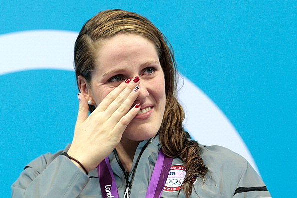 Missy Franklin of the United States wipes a tear from her face