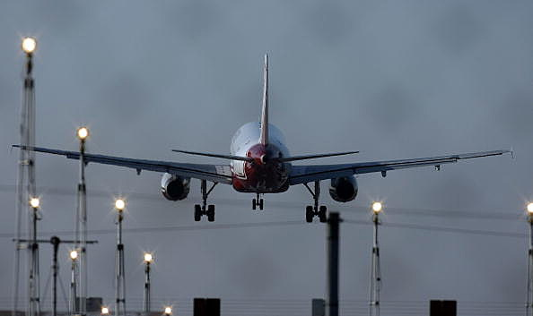 A passenger aircraft landing at Manchester International Airport