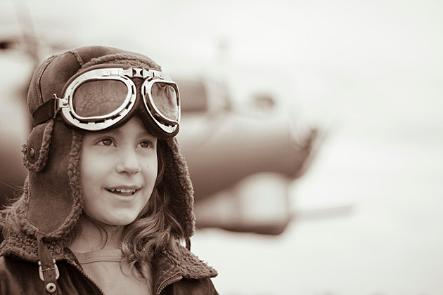 Confident young female pilot looking off into the distance